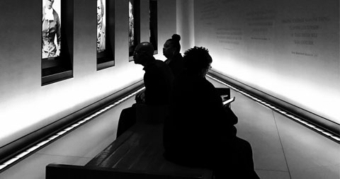 People sitting on a bench in the museum